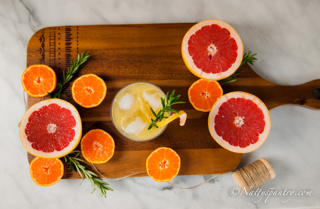 Floral Citrus Cocktail with Grapefruit, Orange, Elderflower, and Rosemary Recipe