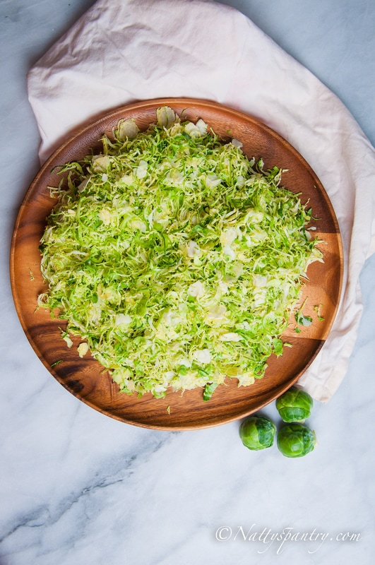 Shaved Brussels Sprouts salad with a Honey-Balsamic Vinaigrette Recipe: Nattyspantry.com